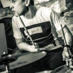Photo of Marko playing the drums