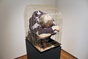 Self Portrait In A Cage, life size figure in a cage, mixed media, 2015